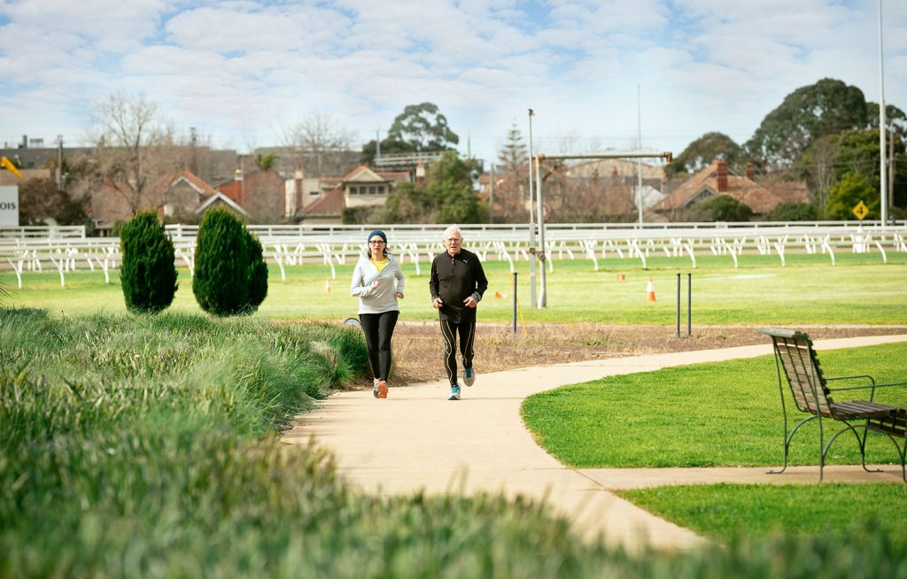 Elderly couple jogging at the Caulfield reserve.